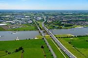Nederland, Gelderland, Zaltbommel, 13-05-2019; bruggen over de rivier de Waal bij Zaltbommel. Naast de spoorbrug, spoorlijn Utrecht - Den Bosch, de Martinus Nijhofbrug voor autoverkeer op rijksweg A2.<br /> Bridges over the River Waal. Railway bridge, railway line Utrecht - Den Bosch and the Martinus Nijhof bridge, motorway A2.<br /> aerial photo (additional fee required); luchtfoto (toeslag op standard tarieven); copyright foto/photo Siebe Swart