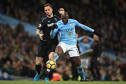West Ham United's Marko Arnautovic (left) and Manchester City's Eliaquim Mangala battle for the ball
