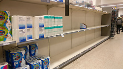 © Licensed to London News Pictures. 05/03/2020. WATFORD, UK.  Stocks of toilet rolls on the shelves of a Waitrose supermarket near Watford run low as the public reacts to the threat of the coronavirus (COVID-19) in the UK.  The number of people diagnosed positive has reached 115 and the first UK death related to coronavirus has just been reported.  Photo credit: Stephen Chung/LNP