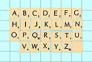 Digitally created image of a full alphabet of scrabble tiles with a spare blank block