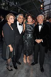 Mayor of London SADIQ KHAN, his wife SAADIYA, ALEXANDRA SHULMAN and GIORGIO ARMANI at British Vogue's Centenary Gala Dinner in Kensington Gardens, London on 23rd May 2016.