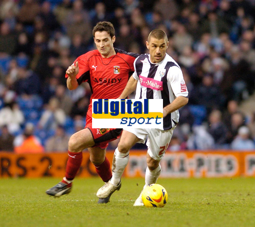 Photo: Leigh Quinnell.<br /> West Bromwich Albion v Coventry City. Coca Cola Championship. 16/12/2006. West Broms Kevin Phillips gets away from Coventrys Clive Clarke.