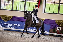 Kronberg, Gestüt Schafhof, KRONBERG _ Int. Festhallen Reitturnier Schafhof Edition 2020<br /> <br /> NUXOLL Sandra (AUT), Hanami OLD<br /> Louisdor-Preis - Finale 2020 <br /> Nachwuchspferde Grand Prix für 8 - 10j. Pferde / Einlaufprüfung <br /> Kurz Grand Prix<br /> Dressurprüfung Kl.S***<br /> <br /> 19. December 2020<br /> © www.sportfotos-lafrentz.de/Stefan Lafrentz