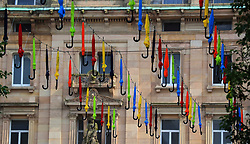 An art installation called the Umbrella Project, which sees 200 brightly coloured umbrellas suspended over Church Alley in Liverpool city centre.
