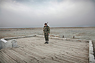 """Armenian Soldier on guard duty at the trenches on the front line with Azerbaijan, by the city of Agdam...Agdam is a ghost town which once had 160,000 residents and an airport. Under Armenian control since July 1993, most of the refugees from Agdam now live in camps and makeshift cities in Azerbaijan. Because of the level of destruction the city ruins are commonly known as the """"Hiroshima of Karabakh.""""Officially  cease-fire line is called ?Nagorno Karabakh Line of Contact ?..As the USSR crumbled, Armenia and Azerbaijan fought a war over Nagorno-Karabakh, a regional conflict that was never fully resolved when Stalin redrew borders and placed the largely Armenian populated region within Azeri jurisdiction. With Russian help, Armenia took control of the region by 1994, resulting in an estimated 800,000 displaced Azeris and 230,000 Armenians. The conflict remains unresolved, both sides still regularly exchange small arms fire. The conflict is the main obstacle to any plans for any Transcaucasus project.."""