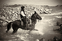 Mounted Gaucho crossing a stream at Estancia Helsingfors in Patagonia. Image taken with a Nikon D3s camera and 24-120 mm f/4  lens (ISO 200, 105 mm, f/4, 1/640 sec)