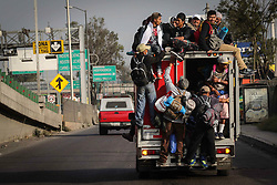 November 10, 2018 - Mexico City, Mexico - People climb onto a truck as the rest of the first contingent of the Migrant Caravan departed from the Jesus Martinez Stadium. They walked through the Peripheral, used public transport and asked for a ride. (Credit Image: © El Universal via ZUMA Wire)