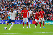 Harry Kane of England scores goal (4-0) from a penalty kick during the UEFA European 2020 Qualifier match between England and Bulgaria at Wembley Stadium, London, England on 7 September 2019.