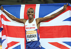 © Licensed to London News Pictures. 24/07/2015. London, UK. British long-distance and middle-distance runner Mo Farah celebrates winning the 3000m in the Diamond League meet at the Olympic Stadium as part of the Sainsbury's Anniversary Games. Photo credit: LNP