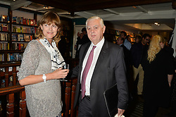 VIRGINIA JOHNSON widow of Frank Johnson and LORD LAMONT at a party to celebrate the publication of Stanley I Resume by Stanley Johnson at the Daunt Bookshop, Marylebone High Street, London on 23rd September 2014.