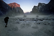 A lone photographer waits for perfect light to capture the grandeur of El Capitan in Yosemite National Park.