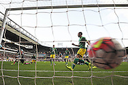 Cheikhou Kouyate of West Ham United shoots to score his sides 2nd goal to make it 2-2. Barclays Premier League, West Ham Utd v Norwich city at The Boleyn Ground, Upton Park in London on Saturday 26th September 2015.<br /> pic by John Patrick Fletcher, Andrew Orchard sports photography.