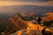 Tourist taking photos at Grand Canyon from Grandview Point, South Rim, Grand Canyon Nat'l. Park, ARIZONA