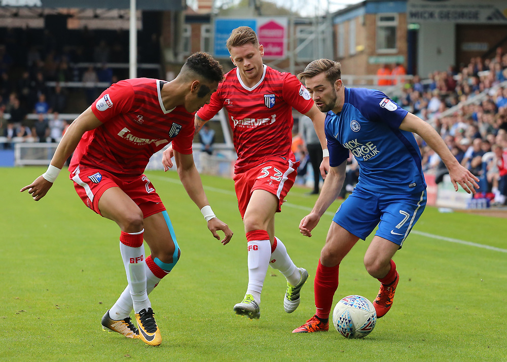 Peterborough United's Gwion Edwards takes on Gillingham's Sean Clare<br /> <br /> Photographer David Shipman/CameraSport<br /> <br /> The EFL Sky Bet League One - Peterborough United v Gillingham - Saturday 14th October 2017 - London Road Stadium - Peterborough<br /> <br /> World Copyright © 2017 CameraSport. All rights reserved. 43 Linden Ave. Countesthorpe. Leicester. England. LE8 5PG - Tel: +44 (0) 116 277 4147 - admin@camerasport.com - www.camerasport.com