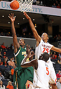 Dec. 20, 2010; Charlottesville, VA, USA; Norfolk State Spartans guard/forward Chris McEachin (35) shoots the ball in front of Virginia Cavaliers center Assane Sene (5) and Virginia Cavaliers forward Akil Mitchell (25) during the game at the John Paul Jones Arena. Mandatory Credit: Andrew Shurtleff