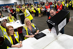 Edinburgh, Scotland, UK. 12th December 2019. First box containing postal votes emptied onto table at Parliamentary General Election Count at the Royal Highland Centre in Edinburgh. Five constituencies are being counted in Edinburgh, Edinburgh West, Edinburgh South West, Edinburgh North & Leith, Edinburgh South and Edinburgh East. Iain Masterton/Alamy Live News