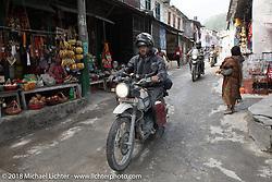 Kiwi Mike Tomas passing through Modibeni on Day-7 of our Himalayan Heroes adventure riding from Tatopani to Pokhara, Nepal. Monday, November 12, 2018. Photography ©2018 Michael Lichter.