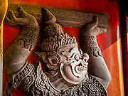 """04 MARCH 2015 - BANGKOK, THAILAND:   A """"hanuman"""" figure on a window shutter in the """"wiharn,"""" or prayer hall at Wat Benchamabophit in the Dusit district of Bangkok.   PHOTO BY JACK KURTZ"""