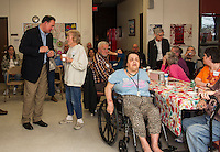 Congressman Frank Guinta speaks with residents at the Laconia Housing Authority Sunrise Towers on Thursday afternoon.  (Karen Bobotas/for the Laconia Daily Sun)