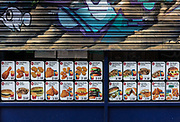 Empty locked burger bar on Brick Lane during the coronavirus pandemic on the 24th April 2020 in London, United Kingdom. Cafes in the United Kingdom were forced to close their doors in late March.