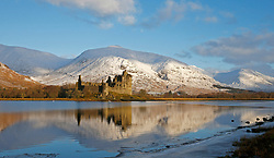 Kilchurn Castle, on Loch Awe was built in the mid-15th century as the base of the Campbells of Glenorchy. Seen here the castle is bathed in the early morning light of a winter sunrise.The most snow on the hills so far this winter.. (c) Stephen Lawson   Edinburgh Elite media