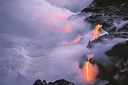 Lava flow entering the sea at twilight, Hawaii Volcanoes National Park, Hawaii