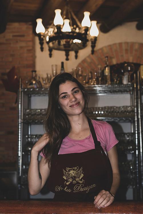 Curitiba, Brazil - April 2, 2019: Rafaella, 19, at work at Vinhos Durigan, where visitors can sample and purchase wine.
