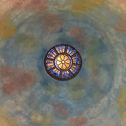 Inside of Trinkle Hall on the University of Mary Washington campus in Fredericksburg, VA, the ceiling dome resembles a kaleidoscope illuminate with color.