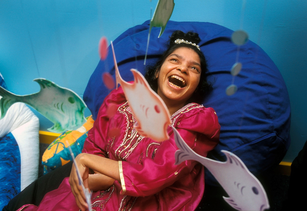 Child with multi disabilities being stimulated in sensory special care home.