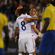 Landon Donovan, USA, celebrates a goal by Mix Diskerud, (left) during his farewell match during the USA Vs Ecuador International match at Rentschler Field, Hartford, Connecticut. USA. 10th October 2014. Photo Tim Clayton