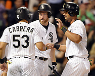 CHICAGO - JUNE 13:  Melky Cabrera #51, Todd Frazier #21 and Jose Abreu #79 of the Chicago White Sox celebrate after Avisail Garcia hit an RBI double against the Baltimore Orioles on June 13, 2017 at Guaranteed Rate Field in Chicago, Illinois.  (Photo by Ron Vesely) Subject:   Melky Cabrera; Todd Frazier; Jose Abreu