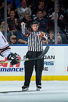 KELOWNA, CANADA - OCTOBER 13: Referee Mark Pearce makes a slashing call at the Kelowna Rockets against the Calgary Hitmen on October 13, 2017 at Prospera Place in Kelowna, British Columbia, Canada.  (Photo by Marissa Baecker/Shoot the Breeze)  *** Local Caption ***