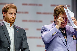 Prince Harry, Duke of Sussex, and Sir Elton John attend a plenary session to launch a new coalition of global Aids funders the MenStar Coalition during the Aids 2018 summit in Amsterdam, the Netherlands, Tuesday July 24, 2018. Photo by Robin Utrecht/ABACAPRESS.COM