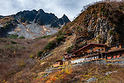 """Karasawa Goya hut, 2360m/7740ft elevation. Karasawa cirque is cradled by the Hotaka Mountains, in the """"Northern Japan Alps"""" (Hida Mountains) in Chubu-Sangaku National Park, Japan. Within the cirque, two lodges provide beds and meals for hikers and climbers: Karasawa Goya and Karasawa Hutte. Also known as Mount Hotaka or Hotaka-dake, the Hotaka Mountains reach 3190 meters elevation atop Mount Oku-Hotaka, Japan's third highest peak. About 2000 meters in diameter, the cirque bottoms out at 2300 m elevation. Snow melting here forms the River Azusa which flows through Kamikochi valley below."""