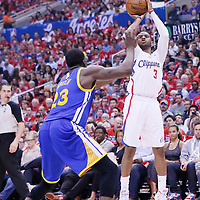21 April 2014: Los Angeles Clippers guard Chris Paul (3) takes a jump shot over Golden State Warriors forward Draymond Green (23) during the Los Angeles Clippers 138-98 victory over the Golden State Warriors, during Game Two of the Western Conference Quarterfinals of the NBA Playoffs, at the Staples Center, Los Angeles, California, USA.