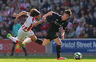 Liverpool's Ben Woodburn breaks away from Stoke city's Joe Allen .Premier league match, Stoke City v Liverpool at the Bet365 Stadium in Stoke on Trent, Staffs on Saturday 8th April 2017.<br /> pic by Bradley Collyer, Andrew Orchard sports photography.