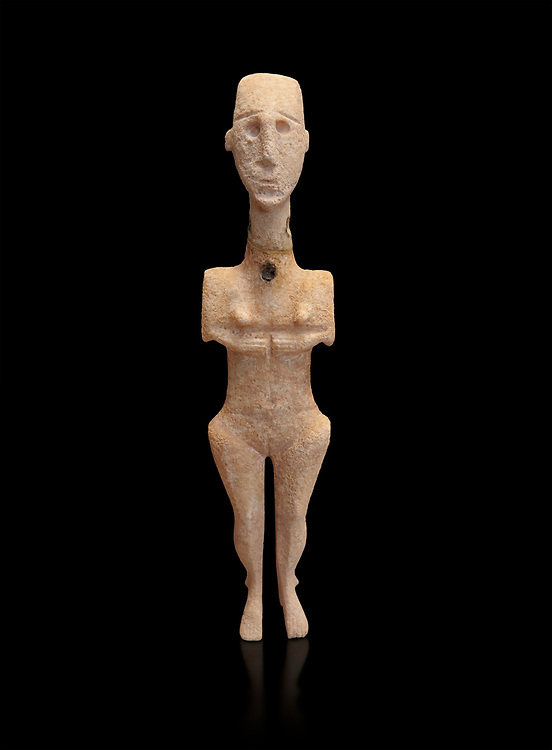 Cycladic statue figurine of the naturalistic 'Plastira' type of Paros. Early Cycladic Period I (Grotta-Pelos Phase 3200-2800 BC). National Archaeological Museum, Athens. Black background.<br /> <br /> This type of Cycladic figurine stand with feet lat to the ground with detailed facial features and ears to make a more realistic statue. .<br /> <br /> If you prefer to buy from our ALAMY PHOTO LIBRARY  Collection visit : https://www.alamy.com/portfolio/paul-williams-funkystock/cycladic-art-artefacts.html Type into the LOWER SEARCH WITHIN GALLERY box to refine search by adding background colour, place, museum etc<br /> <br /> Visit our CYCLADIC CIVILISATIONS PHOTO COLLECTIONS for more photos to download or buy as wall art prints https://funkystock.photoshelter.com/gallery-collection/Cycladic-civilisation-Ancient-Greek-Artefacts-art-Photos-Pictures-Images/C0000CmevVvnC.XU