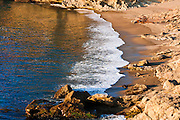 Evening light on surf at Headland Cove, Point Lobos State Reserve, California USA