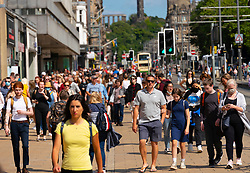 Edinburgh, Scotland, UK. 4th August  2021.  Edinburgh City Centre and Old Town busy this afternoon in warm sunny weather. Pic; Princes Street busy with shoppers. Iain Masterton/Alamy Live news.