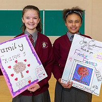 Claire Sweeney and Chelsea NDungih with posters for their project Family Frames