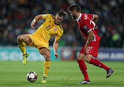 Wales' Gareth Bale (left) and Artiom Rozgoniuc battle for the ball during the 2018 FIFA World Cup Qualifying, Group D match at Stadionul Zimbru in Chisinau, Moldova.