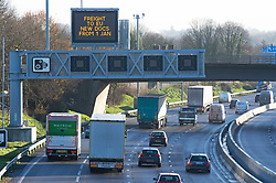 © Licensed to London News Pictures. 17/12/2020. <br /> Maidstone, UK. Freight EU motorway sign over the M20 near Maidstone in Kent. With the Brexit transition period coming to an end on December 31st 2020 freight hauliers travelling to the EU may require a European Conference of Ministers of Transport permit for some journeys from the 1st of January 2021. It is still depend on the UK and EU negotiations as to which permits will be required. Photo credit:Grant Falvey/LNP