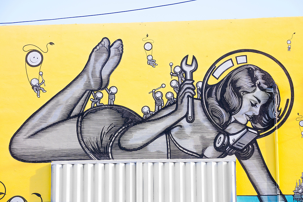 """A giant pin-up girl wears a bubble-like diving helmet and a two-piece bathing suit in a whimsical, 1950s-ish, science fiction-like mural in Miami's Wynwood district created by an Amsterdam-based art collective known as """"The London Police."""""""