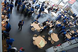 Aerial view of secondary school restaurant at dinner time,