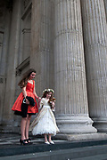 Occupy London Stock Exchange 28.10.2011. St Paul's. Memebers of a wedding party on the steps after the service.