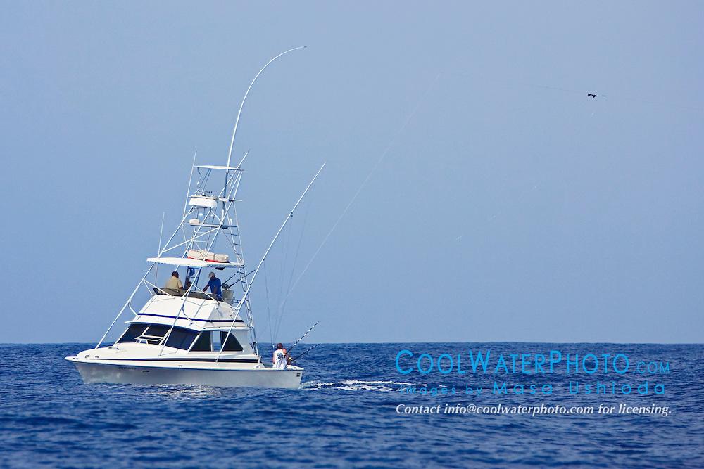"""Sport fishing boat, Ihu Nui, with Hawaiian """"Green Stick"""" tuna rig, off Kona Coast, Big Island, Hawaii, Pacific Ocean."""