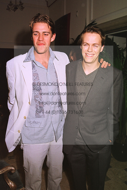 Left to right, MR BEN ELLIOT and his cousin MR TOM PARKER BOWLES son of Camilla Parker Bowles, at a party in London on 4th February 1999.  MOA 27