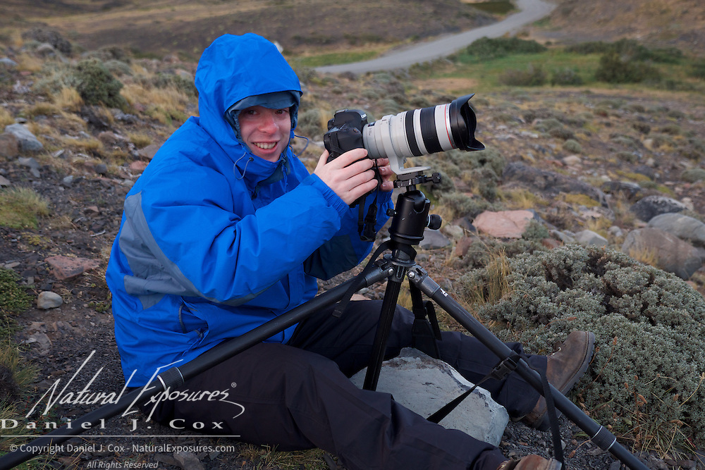 Brian hunkers down from the howling wind in Torres del Paine, NP, Patagonia.