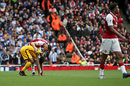 Granit Xhaka Of Arsenal checks on Izzy Brown of Brighton and Hove Albion after he had taken a knock.<br /> Premier league match, Arsenal v Brighton & Hove Albion at the Emirates Stadium in London on Sunday 1st October 2017. pic by Kieran Clarke, Andrew Orchard sports photography.