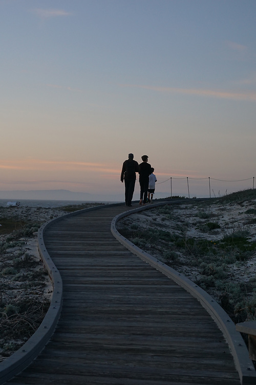 Family on the walkways on the sand dunes of Asilomar Beach and State Park, California